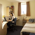 Person working at a desk in university accommodation