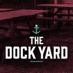 Picnic benches and The Dockyard logo