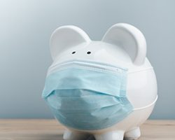 Piggy bank wearing surgical face mask