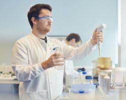 Scientist using equipment in a laboratory